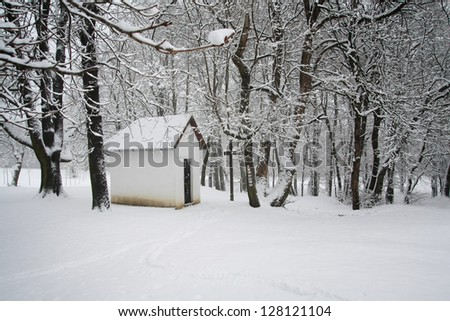 Chapel in the snowy forest - stock photo