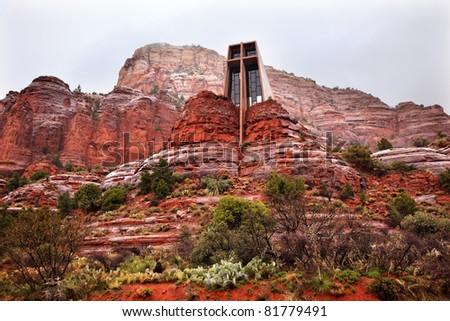Chapel of Holy Cross Red Rock Canyon Rain Clouds Green Trees Cactus Sedona Arizona - stock photo