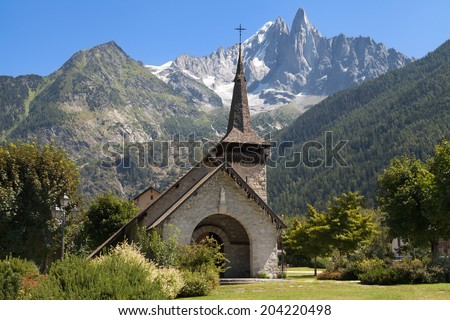 Chapel of Les Praz de Chamonix and the Drus in Haute-Savoie, France. - stock photo