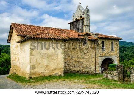 Chapel of St Nicholas in the tiny French hamlet Harambels. - stock photo