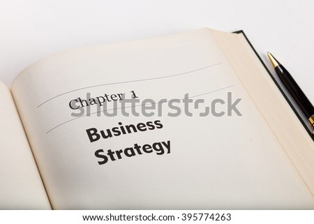 chapter one,  in an open book with a pen, business strategy. fake book.