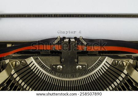 Chapter 4 word printed on an old typewriter - stock photo