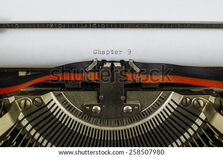 Chapter 9 word printed on an old typewriter - stock photo
