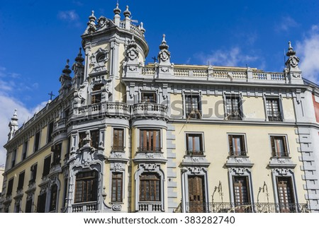 characteristic buildings on the street Gran Via in Madrid, capital of Spain - stock photo