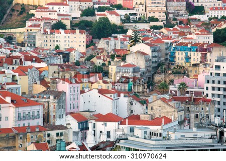 Characteristic colorful view on the city of Lisbon, with the houses randomly distributed over the hills - stock photo