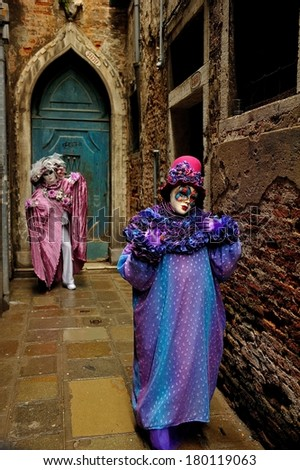 "Characters in a small ""calle"" during the Carnival of Venice, March 2nd, 2014 in Venice, Italy."