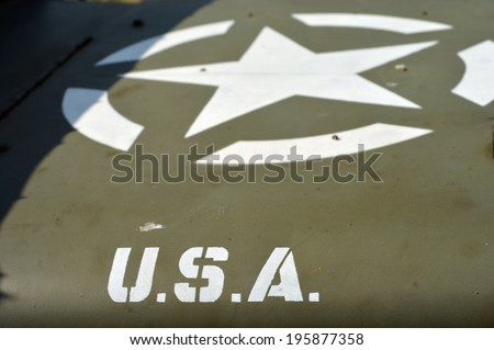 Characters USA and star on a old US army vehicle - stock photo