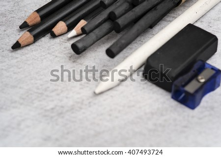 Charcoal artwork and equipments - stock photo