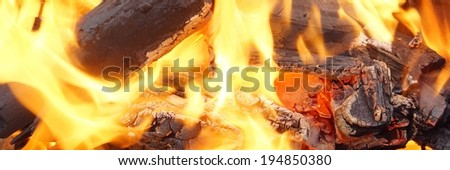 Charcoal Burning in BBQ or in the Fireplace. Background and Texture with space for text or image.   - stock photo
