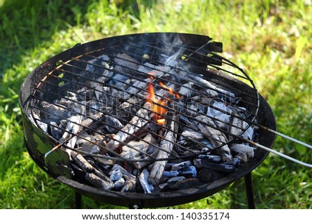 Charcoal fire in barbecue grill - stock photo