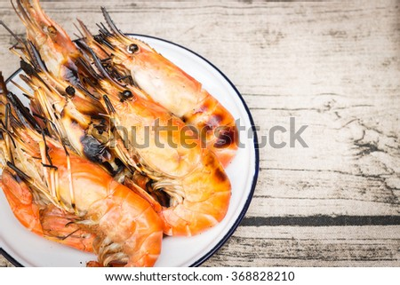 Charcoal grilled river prawns on dish zinc coating vintage style - stock photo