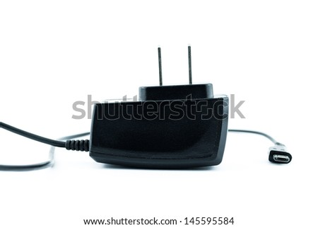 Charger for a mobile gadget isolated on a white background - Cell phone charger - stock photo