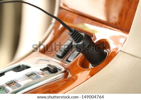 Charger plug on a luxury car - stock photo