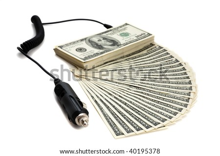 Charger plugged into money to signify recharging, refinancing. - stock photo