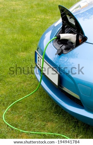 Charging a modern electric car - stock photo