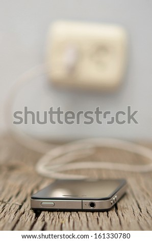 charging mobile phone - stock photo