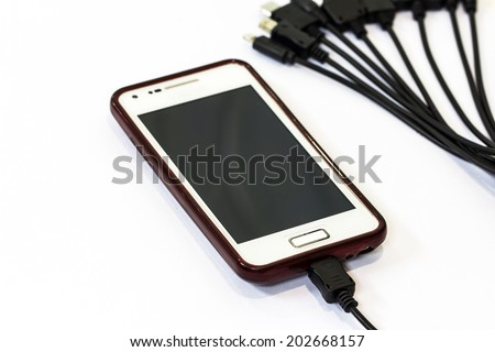 Charging mobile phone isolated on white background