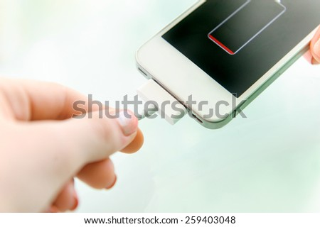 Charging of mobile phone. - stock photo