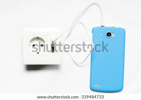 Charging. The smartphone charging from the socket, with two usb-charger ports.