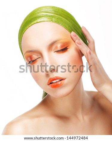 Charisma. Beautiful Woman in Light Green Bandana. Creative Glossy Makeup - stock photo