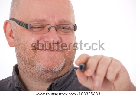 Charismatic adult man using marker. All on white background.