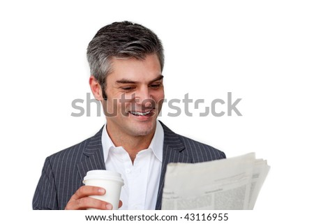 Charismatic businessman drinking a coffee while reading a newspaper against a white background - stock photo