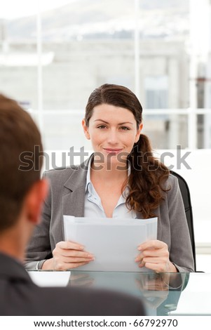 Charismatic businesswoman during an interview with a businessman in her office