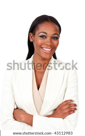 Charismatic businesswoman with folded arms smiling at the camera - stock photo