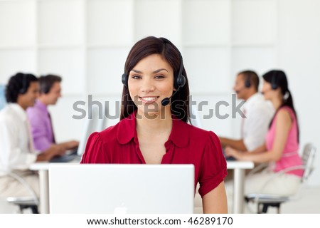 Charismatic Businesswoman with headset on at work - stock photo