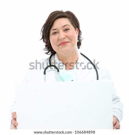 Charismatic doctor holding blank board Smiling friendly charismatic doctor or nurse with a stethoscope holding blank board for your text or advertisement - stock photo
