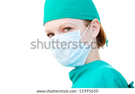 Charismatic female surgeon wearing a mask against a white background