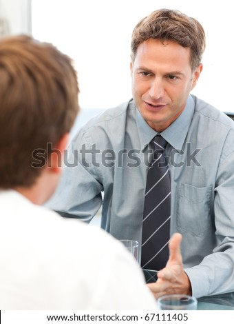 Charismatic manager during a meeting with an employee at the office - stock photo