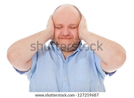 Charismatic middle aged man keeps his ears shut. All on white background.
