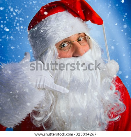 Charismatic Santa Claus makes a motioned to you to call him.