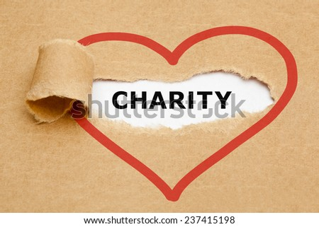 Charity appearing behind torn brown paper. - stock photo