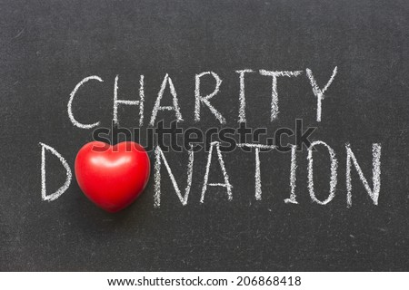 charity donation phrase handwritten on school blackboard with heart symbol instead of O - stock photo