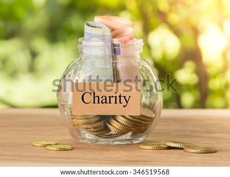 Charity money jar. Concept of Charity,donation,Share. - stock photo