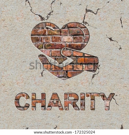 Charity Word and Icon of Heart in the Hand on the Brick Wall. - stock photo