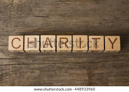 CHARITY word in vintage wooden blocks - stock photo