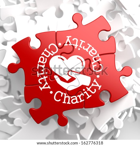 Charity Word Written Around Icon of Heart in the Hand, Located on Red Puzzle. Social Concept. - stock photo