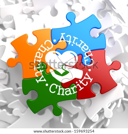 Charity Word Written Arround Icon of Heart in the Hand, Located on Multicolor Puzzle. Social Concept. - stock photo