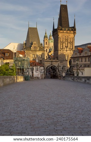 Charles Bridge and Mala Strana Tower in the early morning (Prague, Czech Republic). Vertically. - stock photo