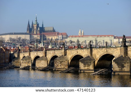 Charles Bridge and Prague Castle in winter - stock photo