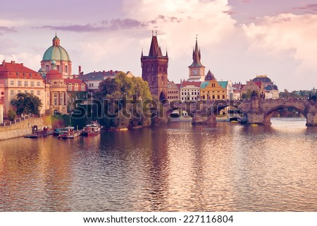 Charles Bridge and spires of the Prague Old Town at the banks of river Vltava - stock photo