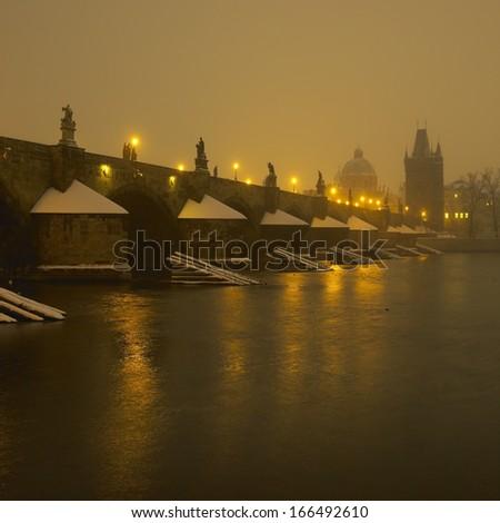 Charles bridge during night in winter, Prague, Czech Republic - stock photo