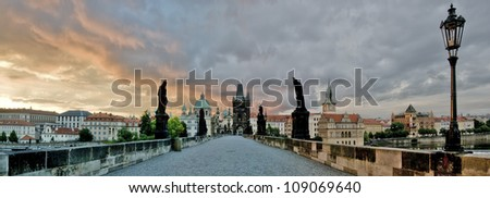 Charles bridge in Prague at sunrise, Czech Republic - stock photo