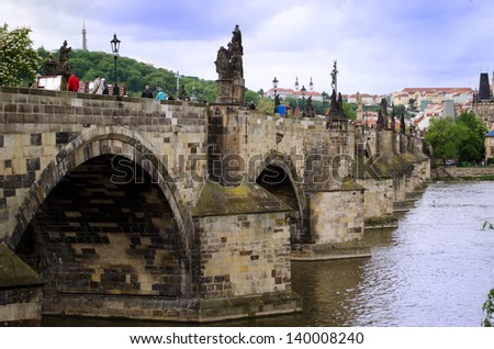 Charles Bridge in Prague, Czech Republic, with tourists - stock photo