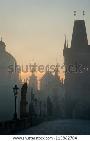 Charles bridge in Prague during misty morning - stock photo