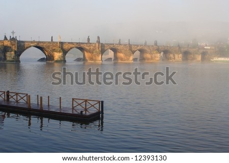 charles bridge in prague in fog