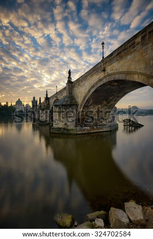 Charles bridge reflection during sunrise, Prague, Czech republic - stock photo